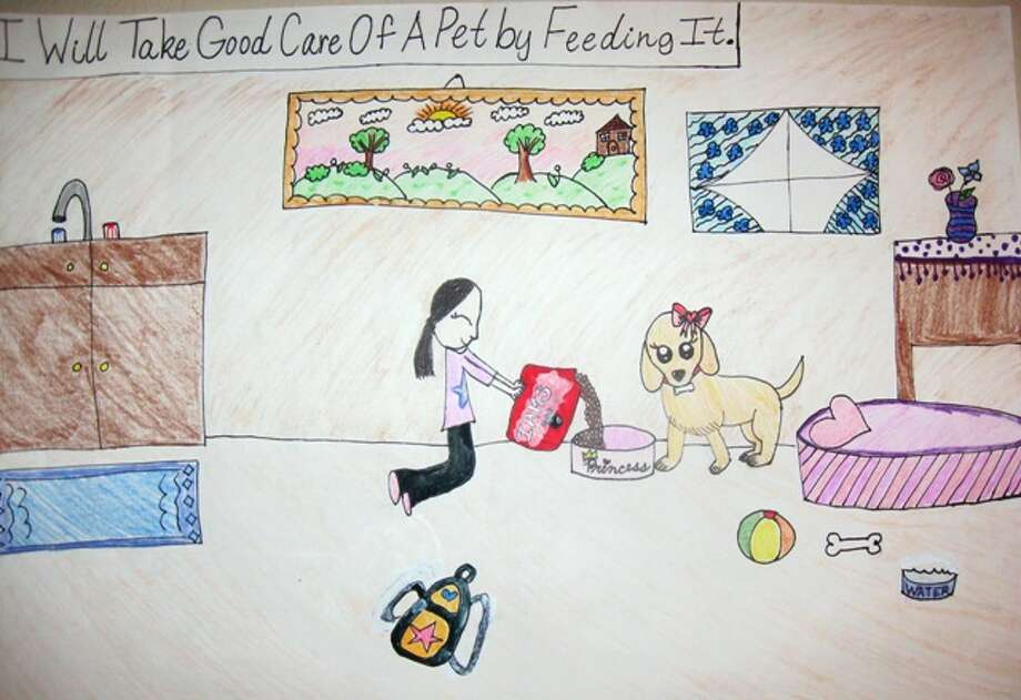 """I will take care of my pet by...""  Fourth Grade, 2nd Place, Joyce H., Charles Beard Elementary School"