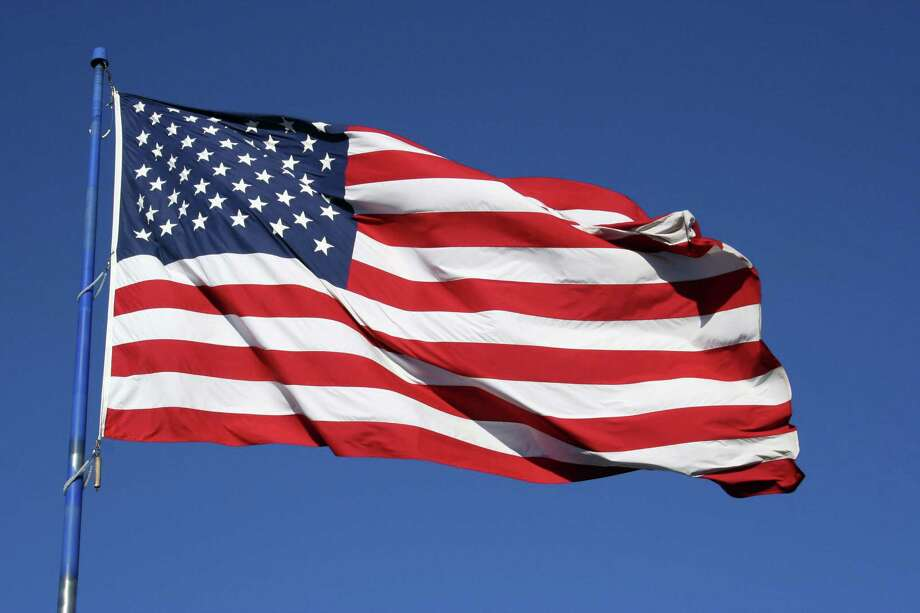 An American flag flapping boldly in the wind. BLUE SKY BACKGROUND Photo: Brandon Seidel / handout / stock agency