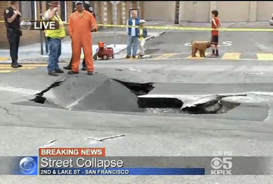 A sinkhole shut down Lake Street and Second Avenue in San Francisco's Richmond District Monday evening. Photo: CBS San Francisco