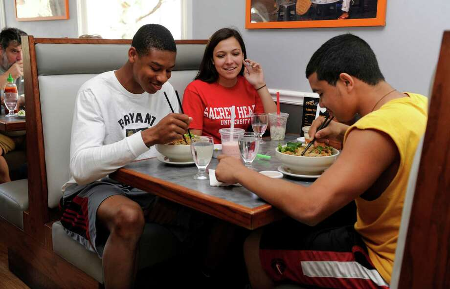 Enjoying lunch at Pho Vietnam Wednesday, May 1, 2013, are from left, Daniel Garvin, 18, Maddie Bedder, 17, and Sam Reyes, 17, all of Bethel. Pho Vietnam is at 56 Padanaram Road in Danbury, Conn. Photo: Carol Kaliff / The News-Times