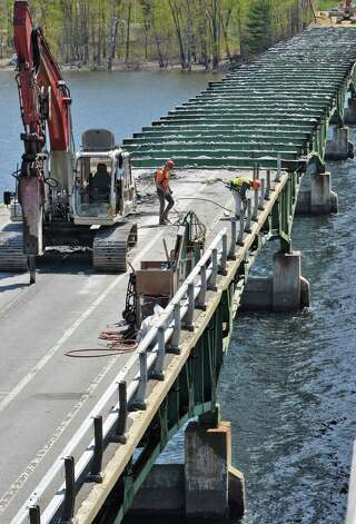 Workers tear down the 83-year old Batchellerville bridge in Edinburg, NY Tuesday May 7, 2013. A new span along side the old one is open for traffic.   (John Carl D'Annibale / Times Union) Photo: John Carl D'Annibale / 10022288A