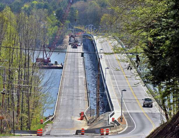 Workers tear down the 83-year old Batchellerville bridge, left, piece by piece as traffic uses the new bridge at right, in Edinburg, NY Tuesday May 7, 2013.   (John Carl D'Annibale / Times Union) Photo: John Carl D'Annibale / 10022288A