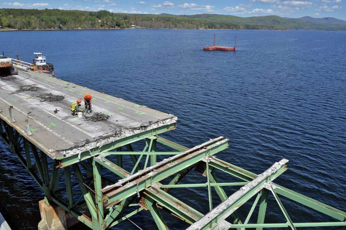 Workers tear down the 83-year old Batchellerville bridge in Edinburg, NY Tuesday May 7, 2013. A new span along side the old one is open for traffic. (John Carl D'Annibale / Times Union)