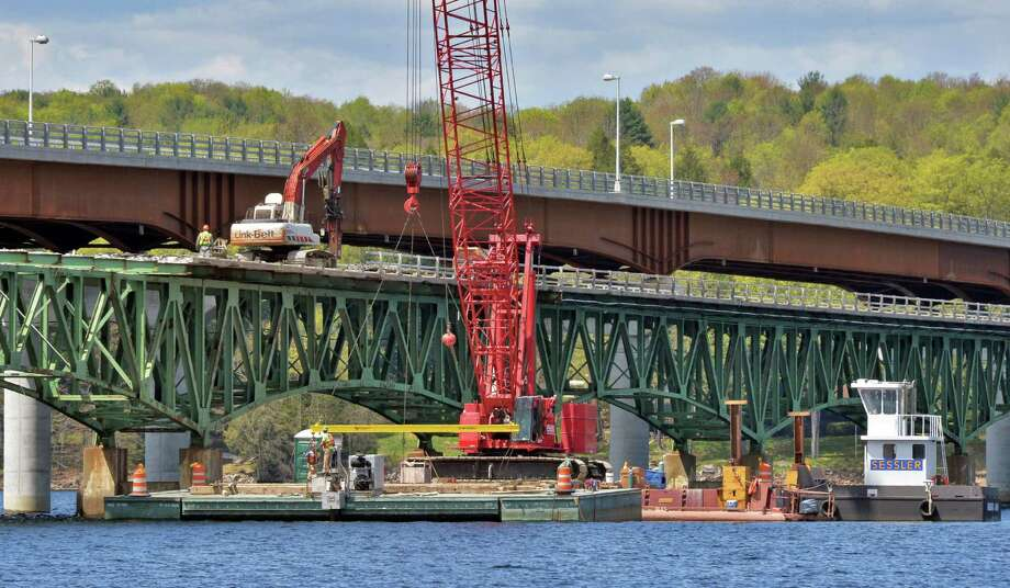 Workers tear down the 83-year old Batchellerville bridge, in foreground, in Edinburg, NY Tuesday May 7, 2013. A new span, top, along side the old one is open for traffic.   (John Carl D'Annibale / Times Union) Photo: John Carl D'Annibale / 10022288A