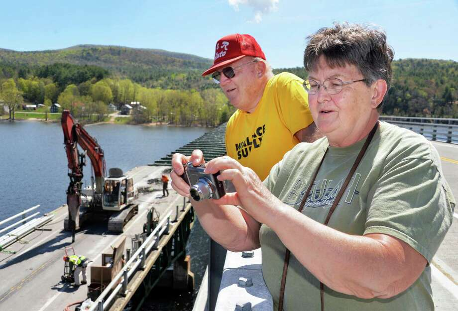 Life-long Edinburg residents Raymond and Beulah Simpson watch as workers tear down the 83-year old Batchellerville bridge piece by piece from the new bridge alongside it in Edinburg, NY Tuesday May 7, 2013.  The pair, who live just up the road, have come out to check on the project once or twice a day since it began last year. Mrs. Simpson has taken almost 2000 photographs since then. (John Carl D'Annibale / Times Union) Photo: John Carl D'Annibale / 10022288A