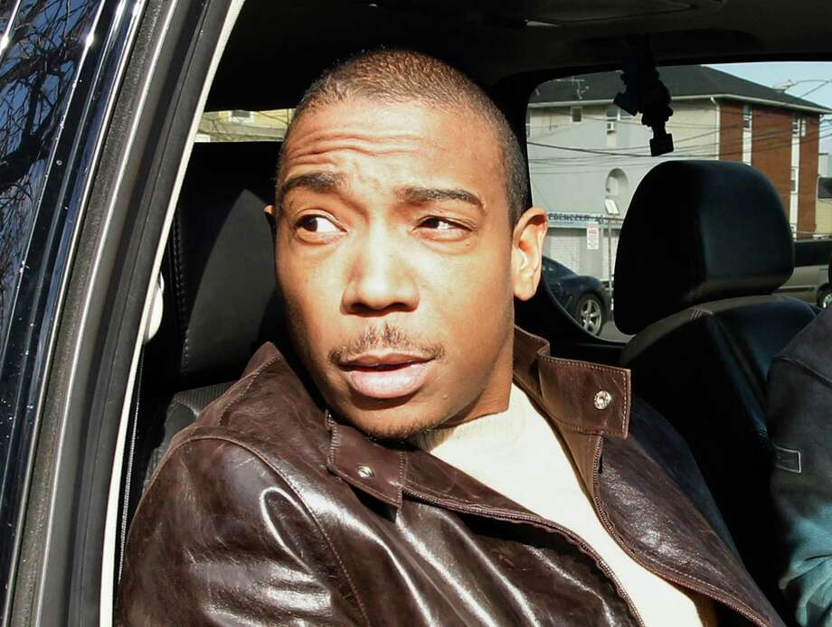 FILE - This March 22, 2011 file photo shows rapper Ja Rule inside a vehicle outside Martin Luther King, Jr. Courthouse after pleading guilty to federal tax evasion charges in Newark, N.J. The Federal Bureau of Prisons says Ja Rule, whose real name is Jeffrey Atkins, left a correctional facility in New York's Adirondacks on Tuesday, May 7, 2013, though time remains on his sentence. Ja Rule had served most of a two-year sentence for illegal gun possession in a New York state prison before his release in February and subsequent transfer into federal custody in the tax evasion case.  (AP Photo/Julio Cortez, file) Photo: Julio Cortez