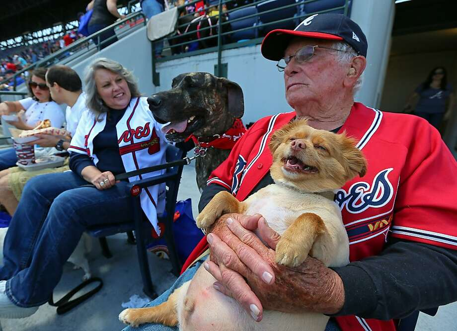 """In baseball, it's not over till the fat doggy laughs:Braves fan George Lavery brought his inflatable dog, Chipper, to the special """"Bark in the Park"""" event at Turner Field. Photo: Curtis Compton, McClatchy-Tribune News Service"""