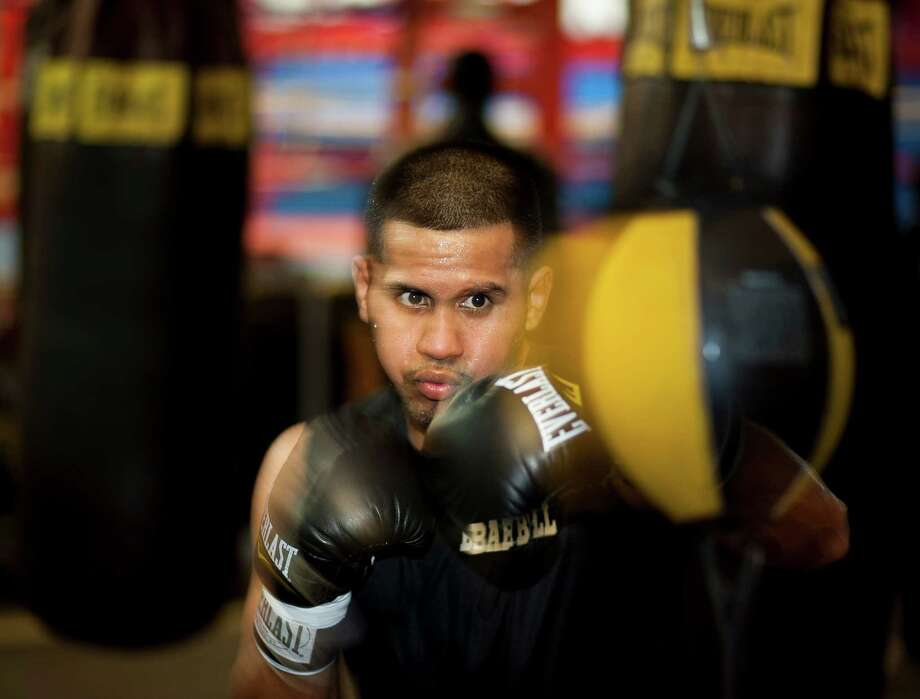 Juan Diaz has a big goal for his comeback: Wearing another title belt. Photo: Nick De La Torre, Staff / © 2013 Houston Chronicle