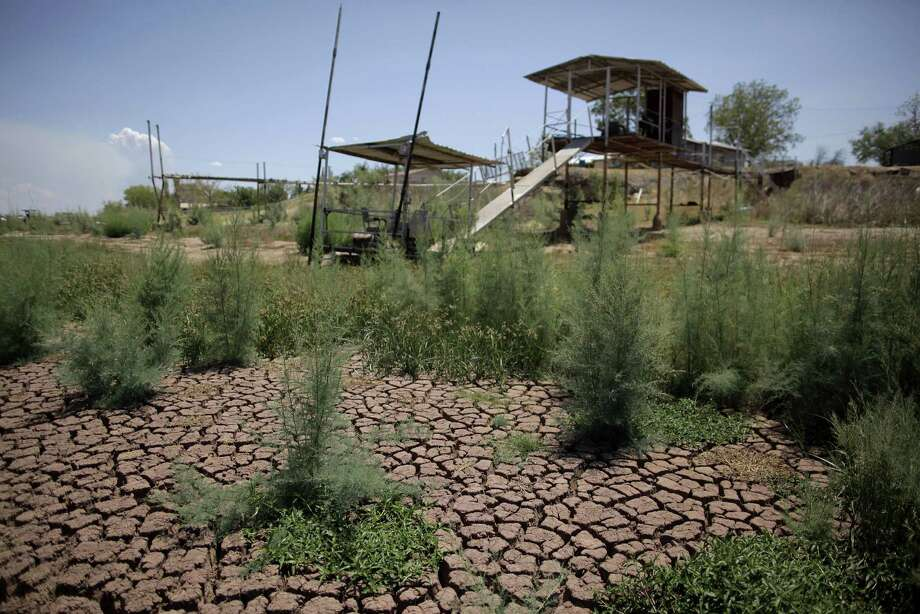 "Docks stand on the dried bed of Lake Colorado City near Colorado City in 2011. Some House members have blocked a bill that would provide seed money for a water infrastructure bank from the Economic Stabilization Fund, aka the ""rainy day fund."" Photo: Associated Press"