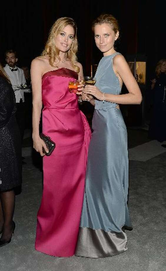 Models Doutzen Kroes and Cato van Ee wear Diamonds from the Tiffany & Co. 2013 Blue Book Collection at the event.