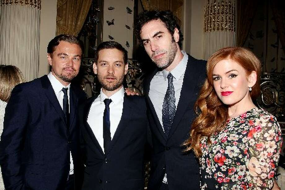 "Actor Leonardo DiCaprio, from left, Tobey Maguire, Sacha Baron Cohen, and Isla Fisher at the after party for the premiere of ""The Great Gatsby"" This May 1, 2013."