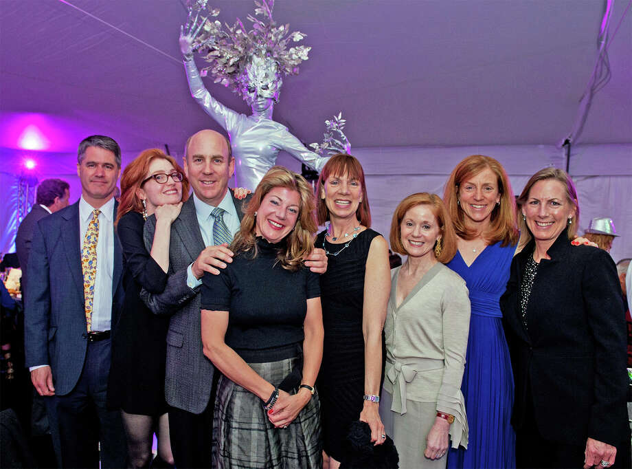 "A living silver ""tree"" greeted guests at the Maritime Aquarium at Norwalk's April 25 Cirque de la Mer fundraiser, including, from left, Jim Hurlock of New Canaan; Elizabeth Jensen, Ken Weil, Monica McNally and Audrey Weil, all of Darien; Patricia Lunka of New York; Kate Hurlock of New Canaan; and Susan Adamsen of Wilton. The event raised more than $630,000 to help the aquarium present its environmental education programming to students in the tri-state area. Photo: Contributed"