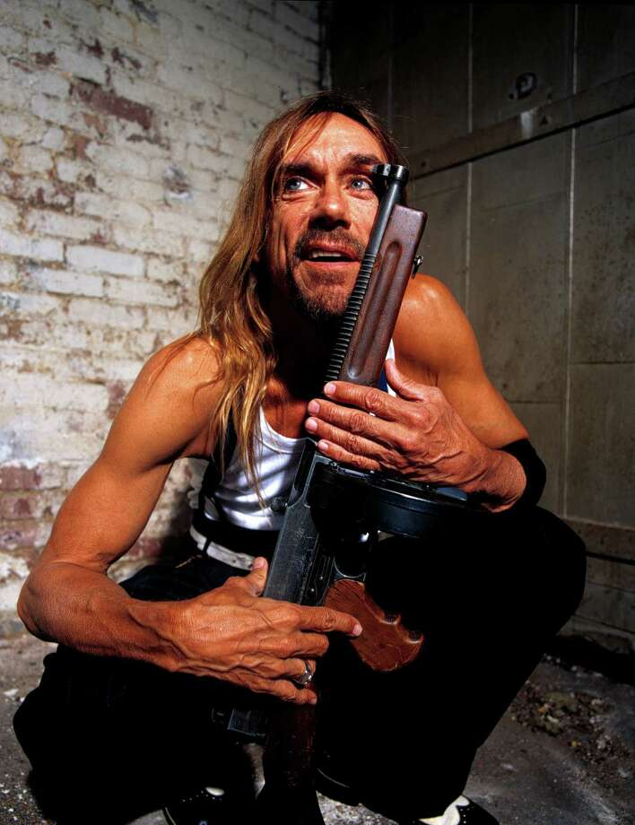 Iggy Pop poses with a Tommy gun in 2001. Photo: Steven Dewall, Getty / 2001 Steven Dewall