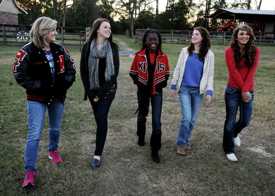 From left to right; Rebekah Richardson, 17, Savannah Short, 14, Ashton Lawrence, 16, Kieara Moffett, 16, and Macy Matthews, 15, chat at the Richardson household on Wednesday, November, 13, 2012.  The Kountze cheerleaders have grown significantly closer with everything they have worked through over the past two months. Photo taken: Randy Edwards/The Enterprise