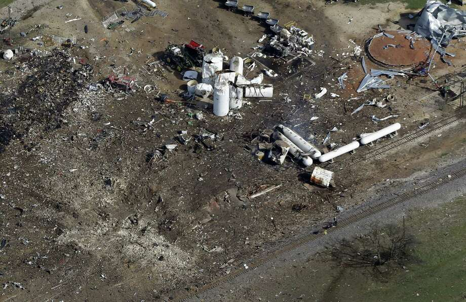 This Thursday April 18, 2013, aerial photo shows a crater, bottom left, the the remains of a fertilizer plant destroyed by an explosion in West, Texas. The massive explosion at the West Fertilizer Co. Wednesday night killed at least 14 people and injured more than 160. (AP Photo/Tony Gutierrez) Photo: Tony Gutierrez, STF / AP