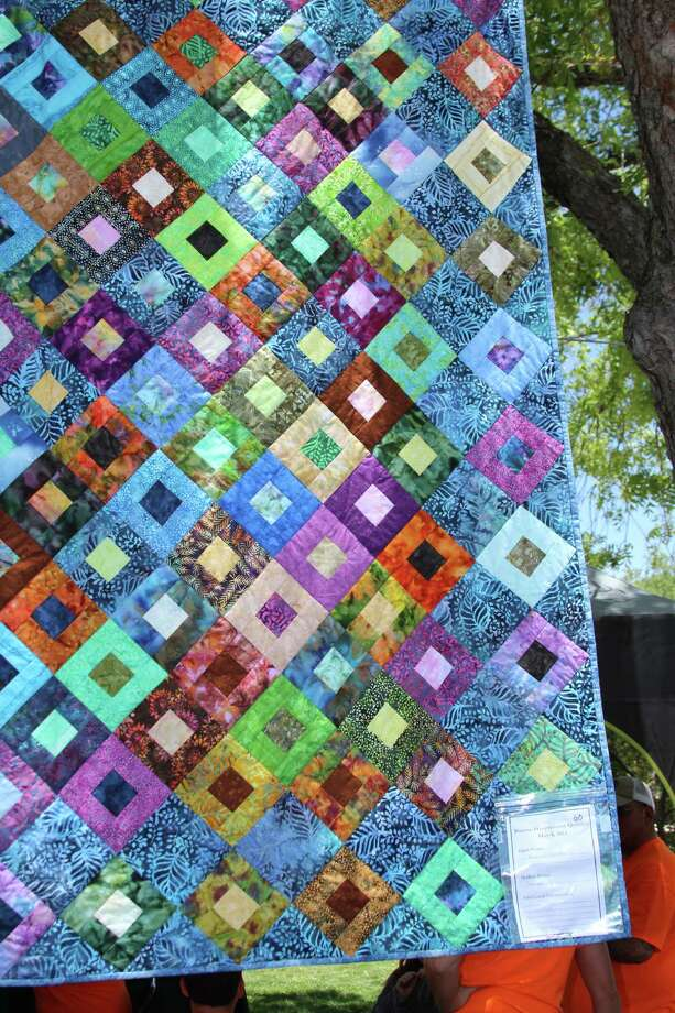"Haupstrasse Quiltfest was held on Boerne's Main Plaza and throughout downtown Saturday, with quilt shows, sales and demonstrations and displays in retail store windows. ""Blue Cobblestones"" was sewn by Patricia Gors. Photo: Lauri Gray Eaton / Northwest Wee"