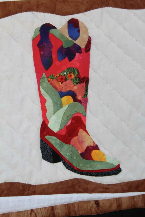 "Haupstrasse Quiltfest was held on Boerne's Main Plaza and throughout downtown Saturday, with quilt shows, sales and demonstrations and displays in retail store windows. ""Boots Galore"" was sewn by Bonnie Gates. This is a close-up of one section. Photo: Lauri Gray Eaton / Northwest Wee"