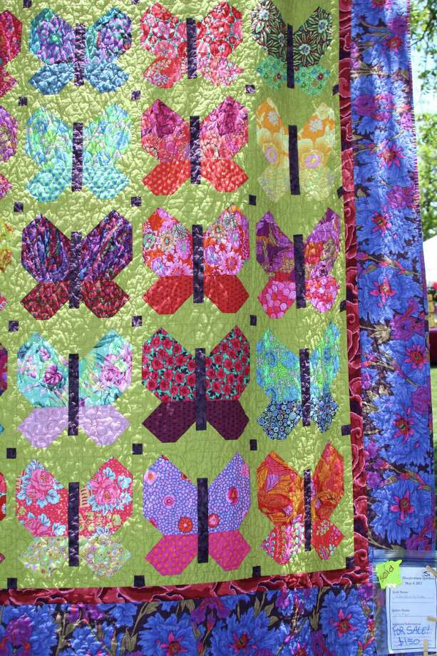 "Haupstrasse Quiltfest was held on Boerne's Main Plaza and throughout downtown Saturday, with quilt shows, sales and demonstrations and displays in retail store windows. ""Butterflies in My Garden"" was sewn by Fae Bryan. Photo: Lauri Gray Eaton / Northwest Wee"