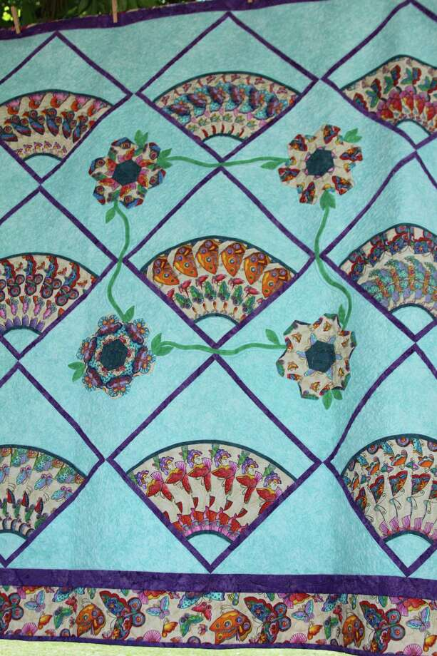 """Haupstrasse Quiltfest was held on Boerne's Main Plaza and throughout downtown Saturday, with quilt shows, sales and demonstrations and displays in retail store windows. """"Butterfly Fans"""" was sewn by Alice Hobbs. Photo: Lauri Gray Eaton / Northwest Wee"""