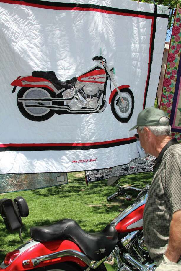 "Haupstrasse Quiltfest was held on Boerne's Main Plaza and throughout downtown Saturday, with quilt shows, sales and demonstrations and displays in retail store windows. ""Ernie's Ride"" was sewn by Karen Walker. Photo: Lauri Gray Eaton / Northwest Wee"