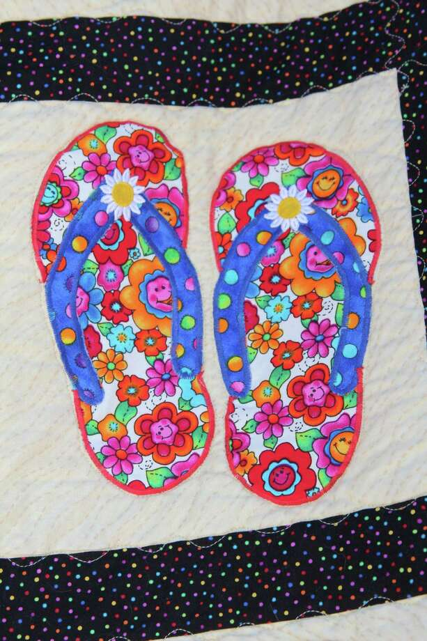 "Haupstrasse Quiltfest was held on Boerne's Main Plaza and throughout downtown Saturday, with quilt shows, sales and demonstrations and displays in retail store windows. ""Hilary's Flip Flops"" was sewn by Diana Albrecht. This is a close-up of one section. Photo: Lauri Gray Eaton / Northwest Wee"