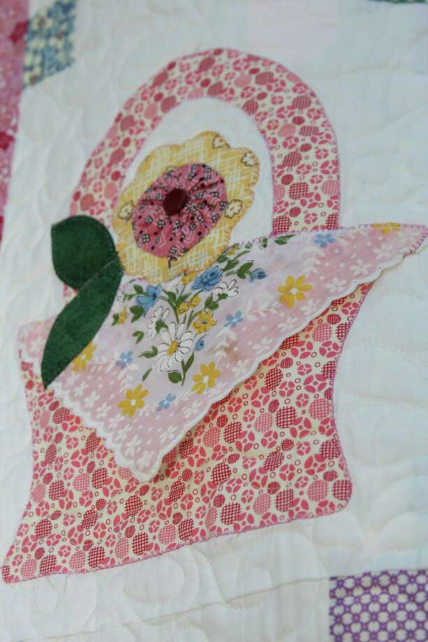 """Haupstrasse Quiltfest was held on Boerne's Main Plaza and throughout downtown Saturday, with quilt shows, sales and demonstrations and displays in retail store windows. """"Hankies"""" was sewn by Stacy Paris. This is a close-up of one section. Photo: Lauri Gray Eaton / Northwest Wee"""