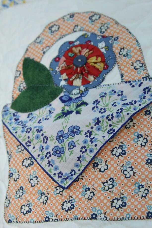 "Haupstrasse Quiltfest was held on Boerne's Main Plaza and throughout downtown Saturday, with quilt shows, sales and demonstrations and displays in retail store windows. ""Hankies"" was sewn by Stacy Paris. This is a close-up of one section. Photo: Lauri Gray Eaton / Northwest Wee"