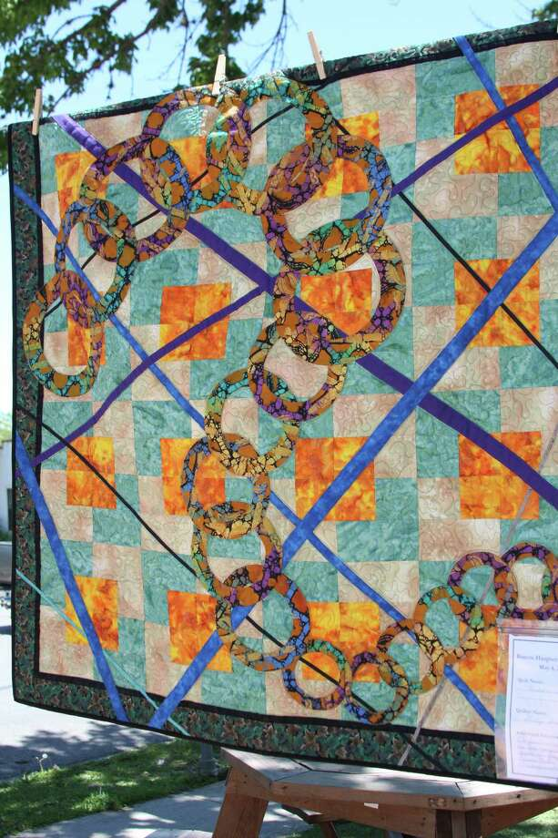 "Haupstrasse Quiltfest was held on Boerne's Main Plaza and throughout downtown Saturday, with quilt shows, sales and demonstrations and displays in retail store windows. ""Round and Round"" was sewn by Shirley Smith. Photo: Lauri Gray Eaton / Northwest Wee"