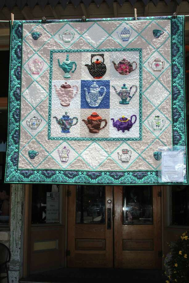 "Haupstrasse Quiltfest was held on Boerne's Main Plaza and throughout downtown Saturday, with quilt shows, sales and demonstrations and displays in retail store windows. ""My Little Teapots"" was sewn by Shirley Smith. Photo: Lauri Gray Eaton / Northwest Wee"
