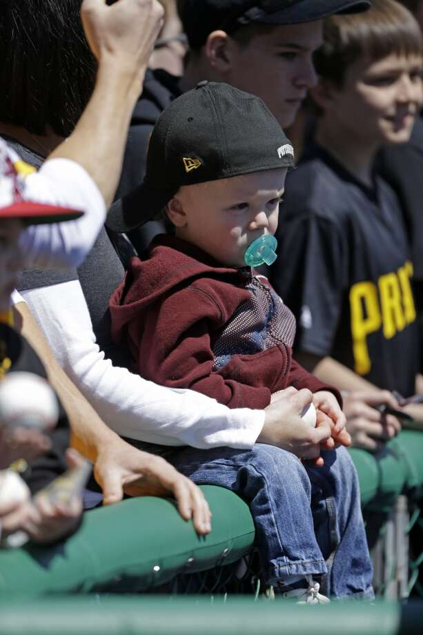 A young Pittsburgh Pirates fan waits for an autograph before a baseball game against the Atlanta Braves in Pittsburgh Sunday, April 21, 2013.