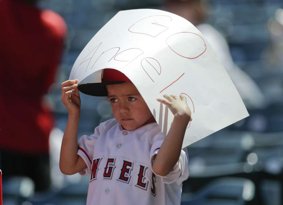 A Los Angeles Angels fan waits for a autograph before a baseball game between the Los Angeles Angels and the Detroit Tigers.