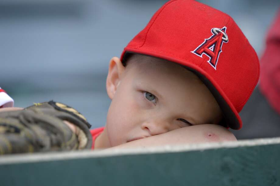 A young fan waits for the baseball game between the Los Angeles Angels and the Baltimore Orioles to start, Sunday, May 5, 2013, in Anaheim, Calif.