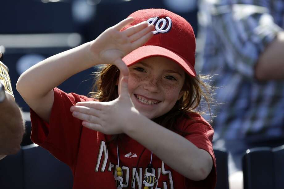 A young Washington Nationals fan watches a baseball game between the Washington Nationals and Pittsburgh Pirates at Pittsburgh Saturday, May 4, 2013.