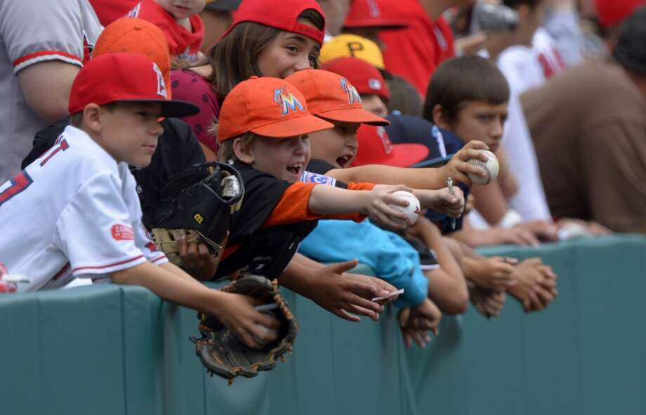 Young fans wait for an autograph prior to a baseball game between the Los Angeles Angels and the Baltimore Orioles on May 5, 2013.