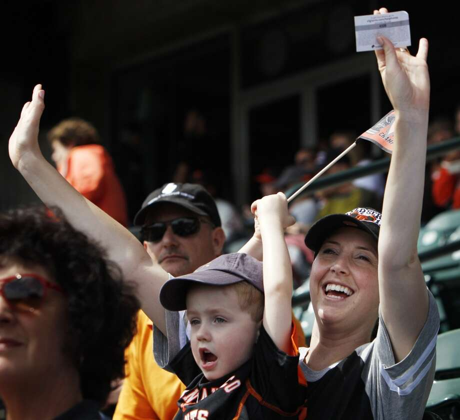 Natalie Okeson and her son Gaine, 3, Giants fans from Utah, cheer as the team is introduced before the game on Friday.
