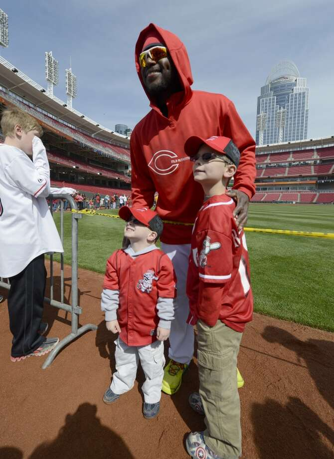 Cincinnati Reds second baseman Brandon Phillips poses for a photograph with fans before a baseball game between the Reds and Miami Marlins.