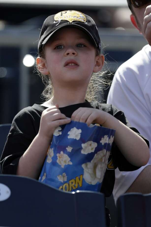 A young Pittsburgh Pirates fan enjoys her popcorn.