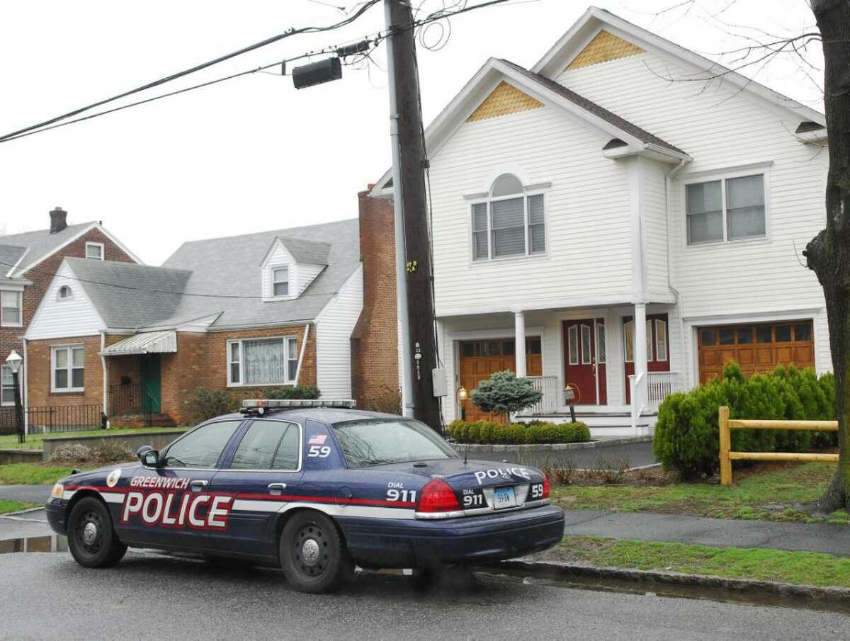 BYRAM TERRACE, A Greenwich police car sits out front 26 Byram Terrace early Friday afternoon.