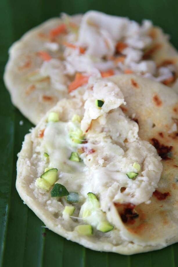 Pupusas with calabaza (squash) and locoro (a wild green) are served at Pupuseria Y Panaderia Emanuel on Tuesday, April 30, 2013, in Houston.  ( Mayra Beltran / Houston Chronicle ) Photo: Mayra Beltran, Staff / © 2013 Houston Chronicle
