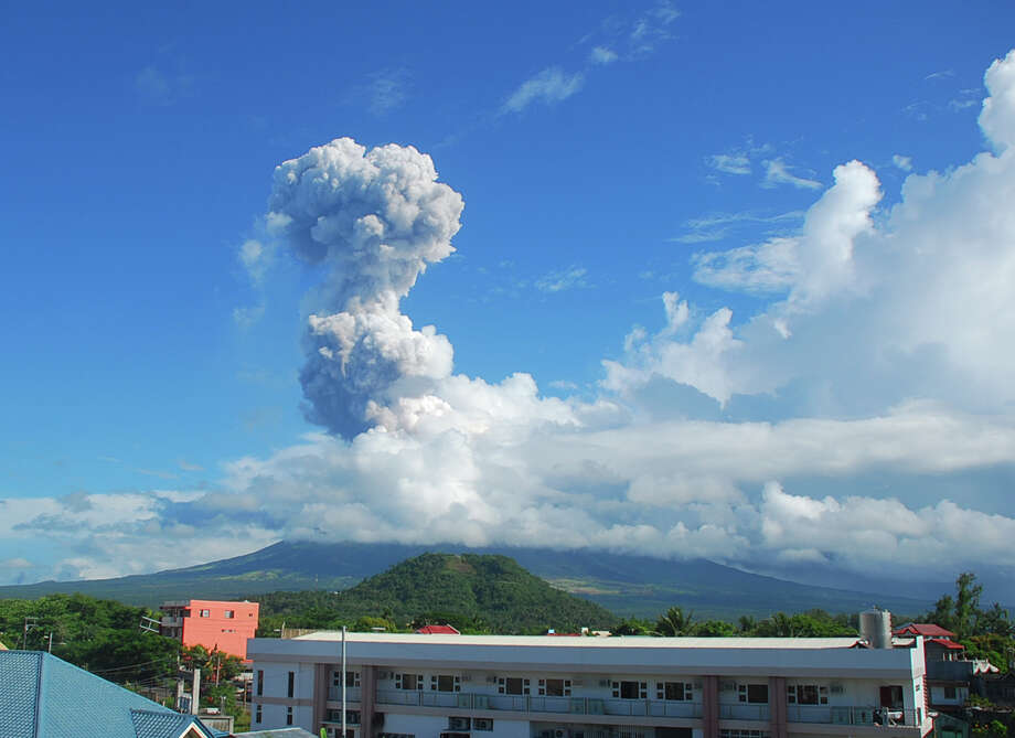 A cloud of volcanic ash shoots up to the sky as Mayon volcano, one of the Philippines' most active volcanoes, erupts after daybreak, viewed from Legazpi city Tuesday, May 7. At least five climbers were killed and more than a dozen others are trapped near the crater in its first eruption in three years, officials said. The list of recent volcanic eruptions that follows comes from Volcano World, a site maintained by Oregon State University, and data provided by the Smithsonian and USGS. (Editor's note: The eruption seen in the images may not be of the current activity and earlier eruptions in the same month were removed.) Photo: Multiple