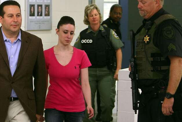 Casey Anthony is escorted by security and attorney Jose Baez as she walks leaves the Orange County Jail on Sunday, July 17, 2011, in Orlando, Florida. (Red Huber/Orlando Sentinel/MCT) Photo: Red Huber, MCT