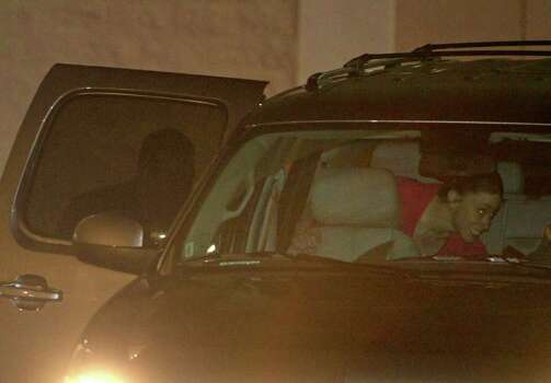 Casey Anthony, right, climbs into an SUV with her lawyer Jose Baez, left, after her release from the Orange County Jail in Orlando, Fla., early Sunday, July 17, 2011.  Anthony was acquitted last week of murder in the death of her daughter, Caylee. (AP Photo/John Raoux) Photo: John Raoux, STF