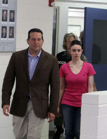 Casey Anthony leaves the Orange County Jail with her attorney Jose Baez, in Orlando, Fla., early Sunday. Photo: Red Huber, Associated Press