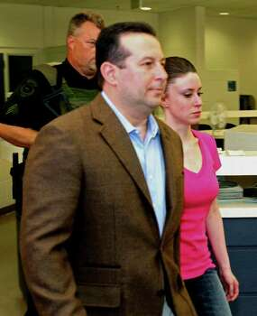 Casey Anthony, front right, walks out of the Orange County Jail with her attorney Jose Baez, left,  during her release in Orlando, Fla., Sunday, July 17, 2011.  Anthony was acquitted last week of murder in the death of her daughter, Caylee. Photo: AP