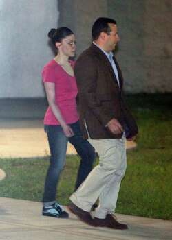 Casey Anthony, left, walks to a SUV with her lawyer Jose Baez after her release from the Orange County Jail in Orlando, Fla., early Sunday, July 17, 2011.  Anthony was acquitted last week of murder in the death of her daughter, Caylee. (AP Photo/John Raoux) Photo: John Raoux, STF / AP
