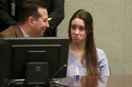 Casey Anthony and her attorney, Jose Baez, during  her sentencing hearing in Orlando, Fla.,Thursday, July 7, 2011. Judge Belvin Perry sentenced Anthony to four years for lying to investigators but says she can go free in late July or early August because she has already served nearly three years in jail and has had good behavior. While acquitted of killing and abusing her daughter, Caylee, Anthony was convicted of four counts of lying to detectives trying to find her daughter. Photo: AP