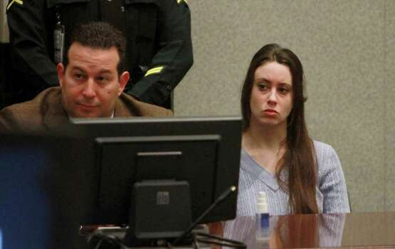 Casey Anthony and her attorney, Jose Baez, listen to arguments during her sentencing hearing in Orlando, Fla.,Thursday, July 7, 2011. Judge Belvin Perry sentenced Anthony to four years for lying to investigators but says she can go free in late July or early August because she has already served nearly three years in jail and has had good behavior. While acquitted of killing and abusing her daughter, Caylee, Anthony was convicted of four counts of lying to detectives trying to find her daughter. Photo: AP