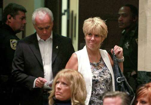 George and Cindy Anthony enter the courtroom before the sentencing hearing for their daughter, Casey, at the Orange County Courthouse Orlando, Fla., Thursday, July 7, 2011.  Casey was acquitted on murder charges but was found guilty of lying to law enforcement. Photo: AP