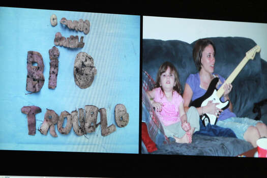 An image displayed on a courtroom monitor shows a photo entered into evidence in the Casey Anthony trial at the Orange County Courthouse on Friday, June 10, 2011. Photo on the left shows wording found on a shirt. The photo on the right shows Caylee Anthony with her mother Casey. Caylee is wearing a shirt with the same lettering.  Anthony, 25, is charged with killing her daughter Caylee in the summer of 2008. Photo: AP