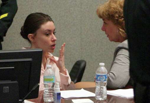 Casey Anthony, left, talks to her attorney, Dorothy Clay Sims, during the second day of jury deliberations in her murder trial in Orlando, Fla., Tuesday, July 5, 2011. Anthony has pleaded not guilty to first-degree murder in the death of her daughter, Caylee. Photo: AP